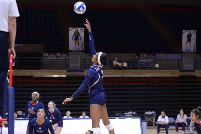 Jade Strawberry goes up for a kill during UConn's match at Gampel Pavilion. (Jason Jiang/The Daily Campus)