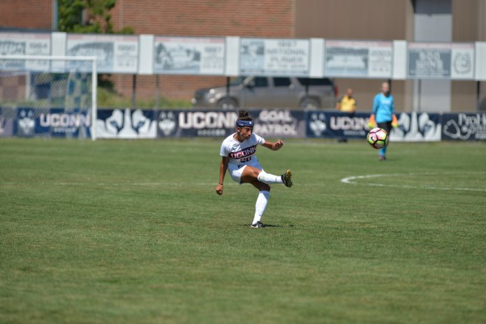 Junior forward Faith McCarty plays a pass during UConn's 2-0 loss to Rutgers at Morrone Stadium on Aug. 28, 2016. (Amar Batra/The Daily Campus)