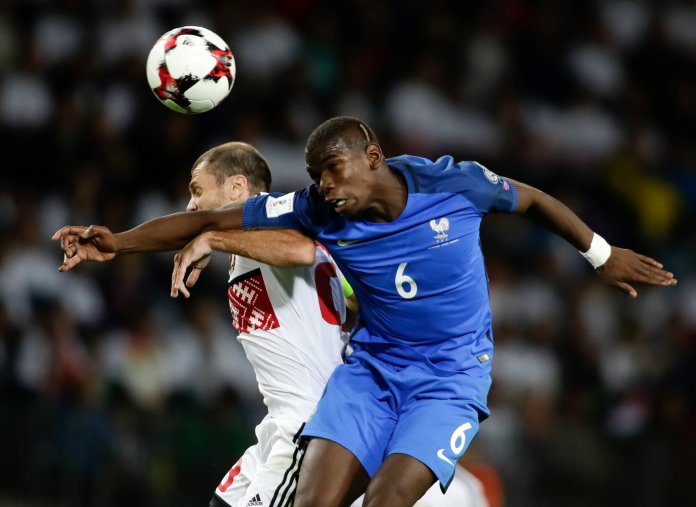 France's Paul Pogba, right, heads the ball with Belarus' Ivan Maevski during their World Cup Group A qualifying match between France and Belarus at the Borisov-Arena stadium in Borisov, Belarus, Tuesday, Sept. 6, 2016. (Sergei Grits/AP)