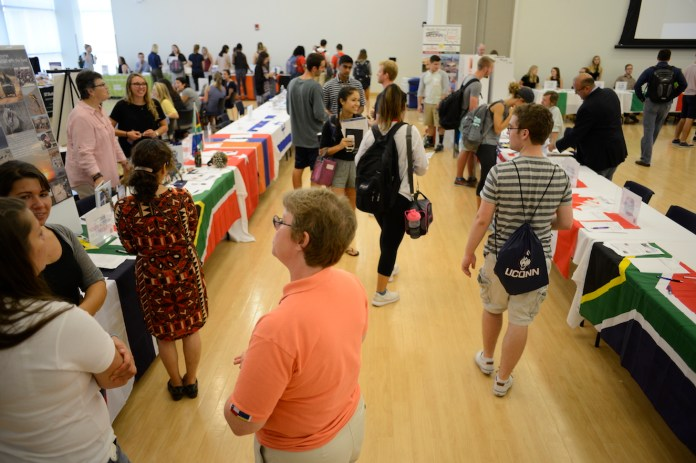 Students explore the UConn Study Abroad fair. (Jason Jiang/The Daily Campus)