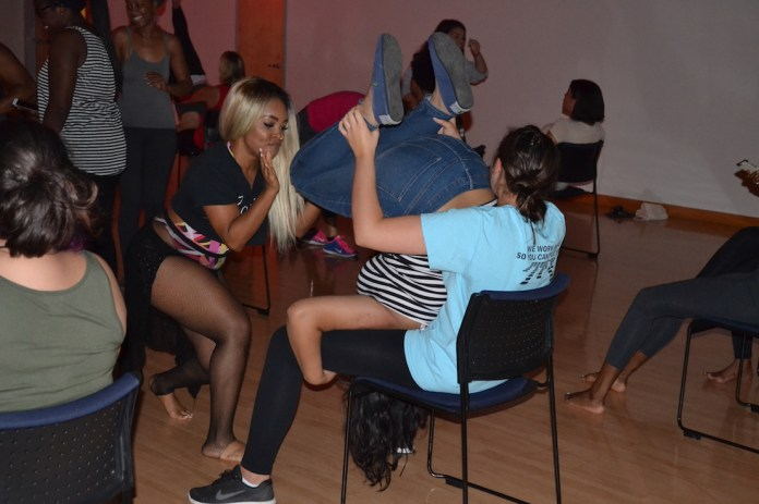 """Edidiong """"Diddi"""" Emah, a choreographer for artists such as Fifth Harmony, Ciara, Usher, TInashe, and Jennifer Lopez, lead a 90 minute workshop to learn a heels dance in the Student Union Ballroom. (Olivia Stenger/The Daily Campus)"""