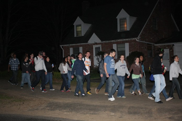 Students walking outside a home on Storrs Road in 2010. UConn and the town of Storrs have long found tension over the off-campus housing scene, especially when it comes to parties that end in noise complaints or massive groups of students.(File Photo/The Daily Campus)