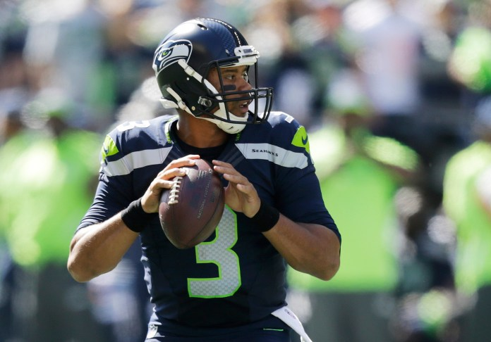 Seattle Seahawks quarterback Russell Wilson passes against the Miami Dolphins in the first half of an NFL football game, Sunday, Sept. 11, 2016, in Seattle. (Stephen Brashear/AP)