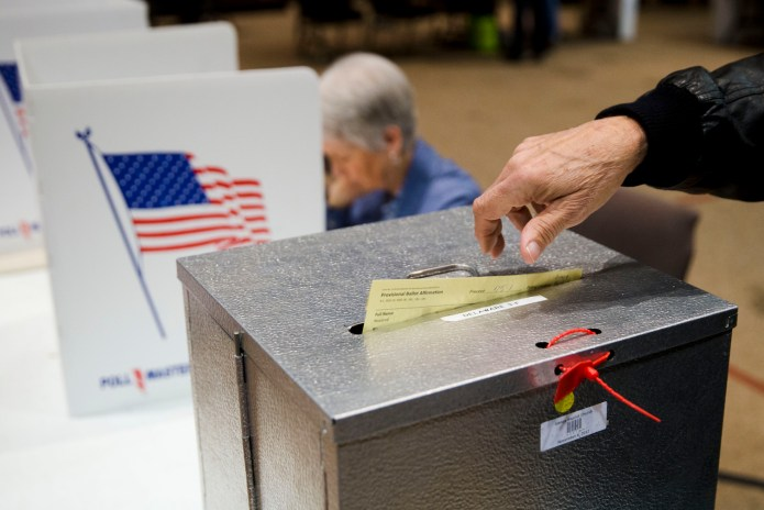In this March 15, 2016, file photo, a primary election voter casts a provisional ballot at a polling place in Westerville, Ohio.(Matt Rourke/AP)