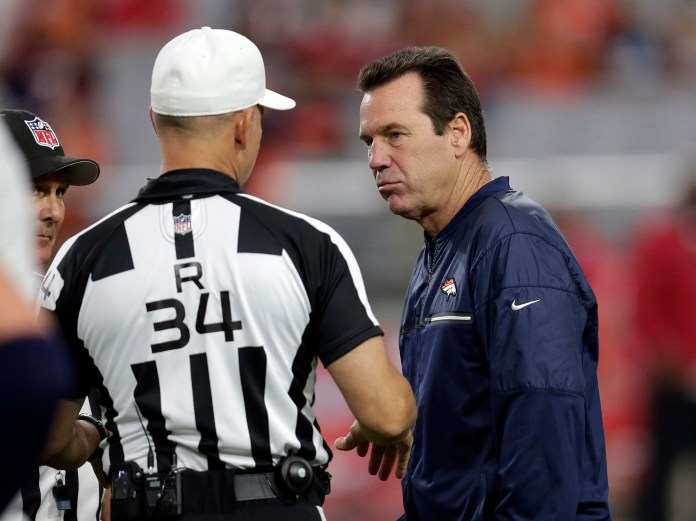 Denver Broncos head coach Gary Kubiak talks with referee Clete Blakeman (34) prior to an NFL preseason football game against the Arizona Cardinals, Thursday, Sept. 1, 2016, in Glendale, Ariz. (AP Photo/Rick Scuteri)