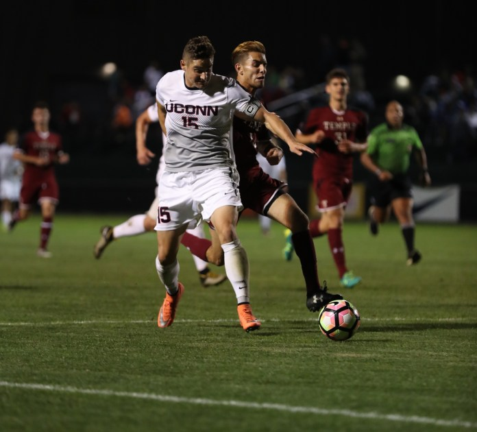 Defensive player  Jakob Nerwinski goes up against a Temple opponent on Saturday, Sept. 24 in the 1-0 win at Joseph J. Morrone Stadium. (Ruohan Li/The Daily Campus)