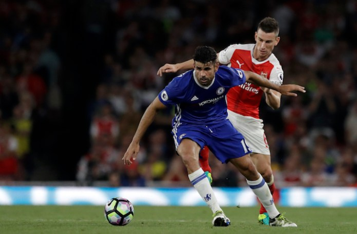 Chelsea's Diego Costa, left, is chased by Arsenal's Laurent Koscielny during the English Premier League soccer match between Arsenal and Chelsea at the Emirates Stadium in London, Saturday, Sept. 24, 2016. (Matt Dunham/AP Photo)