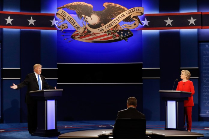 Republican presidential nominee Donald Trump answers a question as Democratic presidential nominee Hillary Clinton listens during the presidential debate at Hofstra University in Hempstead, N.Y., Monday, Sept. 26, 2016. (David Goldman/AP)