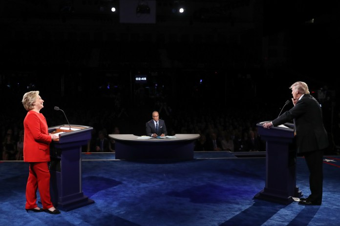 Democratic presidential nominee Hillary Clinton listens as Republican presidential nominee Donald Trump answers a question during the presidential debate at Hofstra University in Hempstead, N.Y., Monday, Sept. 26, 2016. (Joe Raedle/AP)
