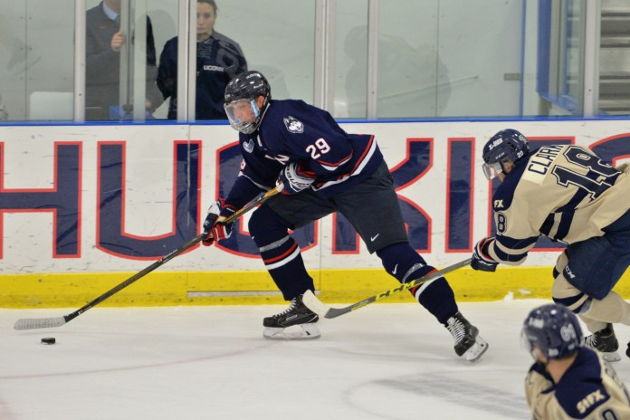 Sophomore forward Tage Thompson maneuvers past a St. Francis Xavier player during the Huskies 4-3 loss in Freitas Ice Forum on Saturday, Oct. 1, 2016. Thompson scored one of the Huskies three goals during the match. (Amar Batra/The Daily Campus)