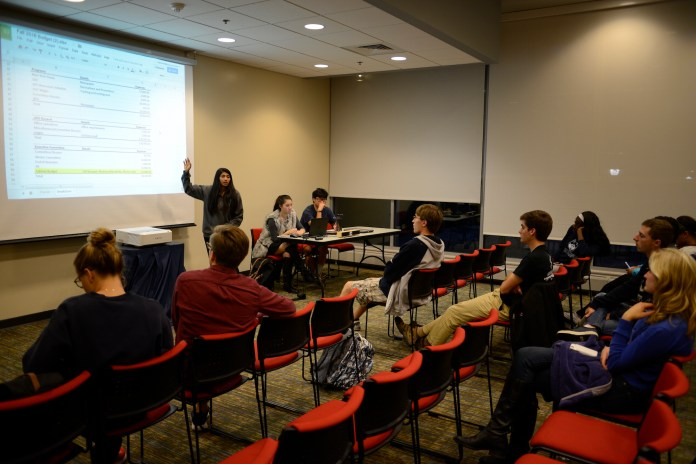 This photo of USG caucus from Sept. 28 2016 shows members discussing the budget of the current year.A vote by USG last week approved four changes to the constitution, but the results for new USG senators are being temporarily suspended in the wake of two election violations cases. (Jason Jiang/The Daily Campus)
