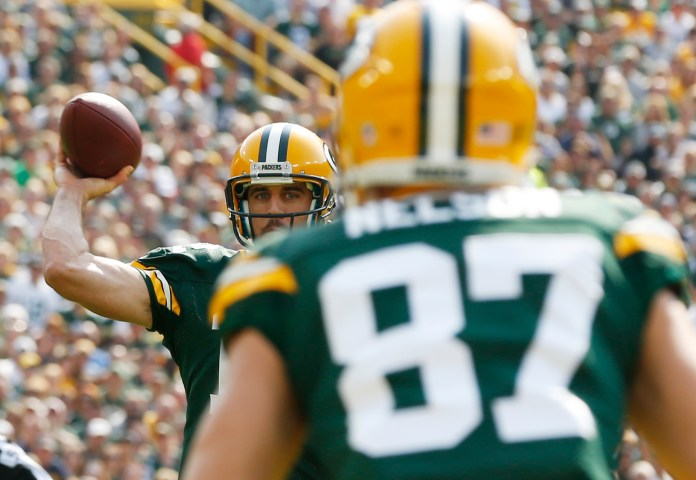 Green Bay Packers quarterback Aaron Rodgers throws a touchdown pass to Jordy Nelson (87) during the first half of an NFL football game against the Detroit Lions Sunday, Sept. 25, 2016, in Green Bay, Wis. (AP Photo/Mike Roemer)
