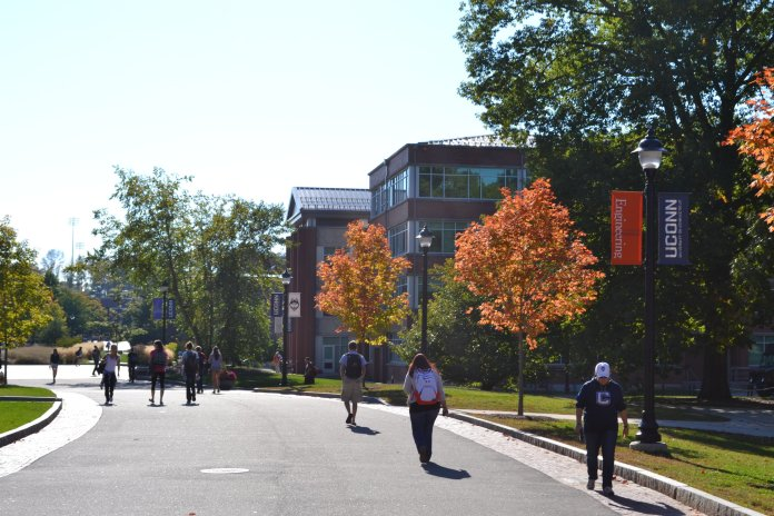 Students walk along Fairfield Way at UConn Storrs.This week, the editorial board covers the importance of grants.(File photo/The Daily Campus)