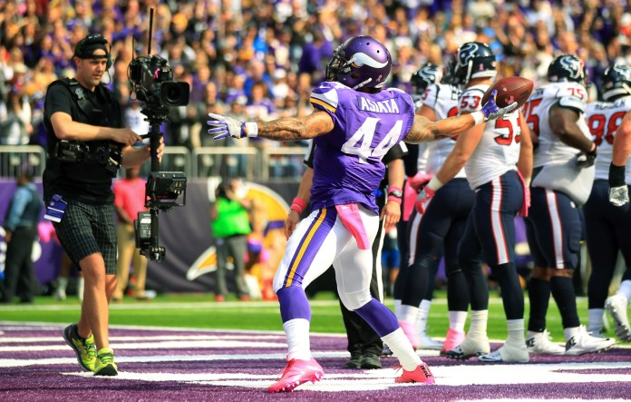 Minnesota Vikings running back Matt Asiata celebrates after scoring on a 1-yard touchdown run during the first half of an NFL football game against the Houston Texans, Sunday, Oct. 9, 2016, in Minneapolis. The Vikings won 31-13. (Andy Clayton-King/AP)