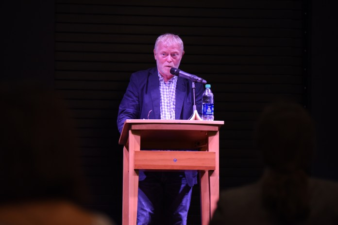 Frank Ormsby, an Northern Ireland-born poet, shared his poem with UConn students at the B&N bookstore at the Storrs center on Tuesday night. (Zhelun Lang/The Daily Campus)
