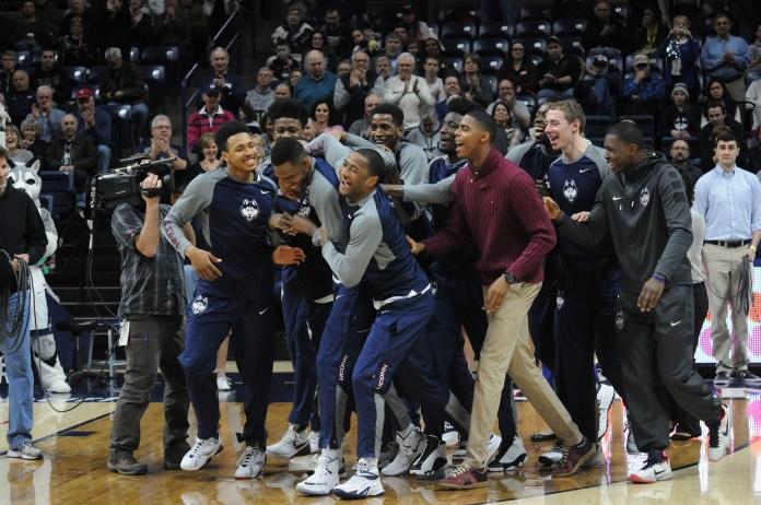UConn men's basketball team with coach Kevin Ollie at their regular season ending game against UCF at Gampell Pavillion March 6, 2016. The team now gears up to welcome their freshman players. (Bailey Wright/ The Daily Campus)