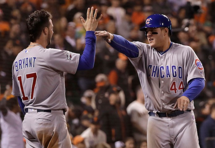 Chicago Cubs' Kris Bryant (17) and Anthony Rizzo (44) celebrate during the ninth inning of Game 4 of baseball's National League Division Series against the San Francisco Giants in San Francisco, Tuesday, Oct. 11, 2016. The Cubs are favorites to break their 108-year curse and win the World Series.(Marcio Jose Sanchez/AP Photo)