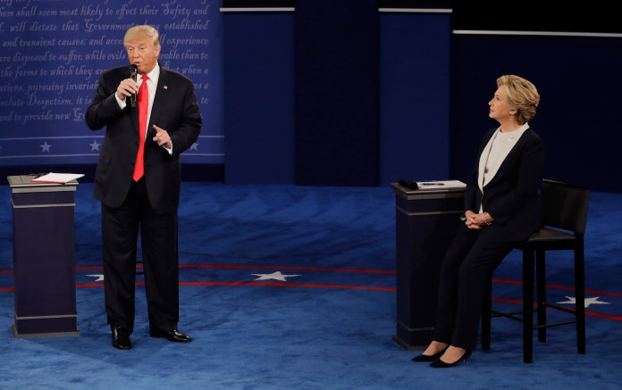 Democratic presidential nominee Hillary Clinton  listens to Republican presidential nominee Donald Trump   during the second presidential debate at Washington University in St. Louis, Sunday, Oct. 9, 2016.(Patrick Semansky/AP)