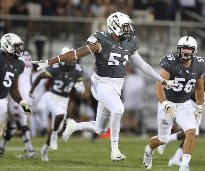 Central Florida linebacker Errol Clarke (51) celebrates after a stop against Temple during an NCAA college football game in Orlando, Fla., on Saturday, Oct. 15, 2016. (Stephen M. Dowell/Orlando Sentinel via AP)