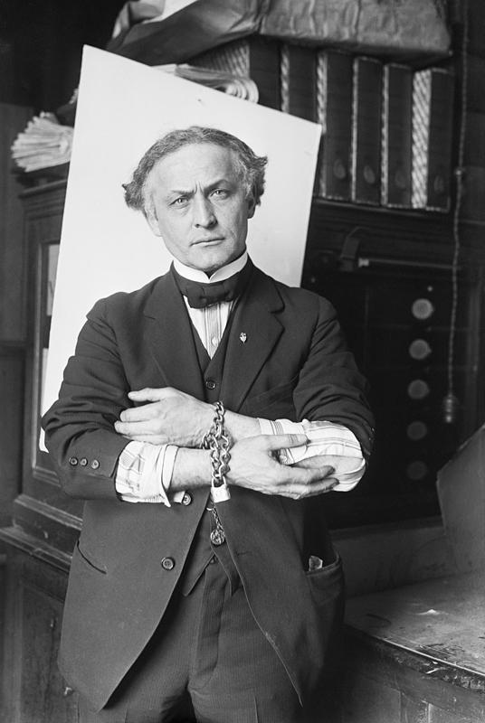 Houdini in handcuffs, 1918. (The New York Times photo archive/Wikipedia via Creative Common)