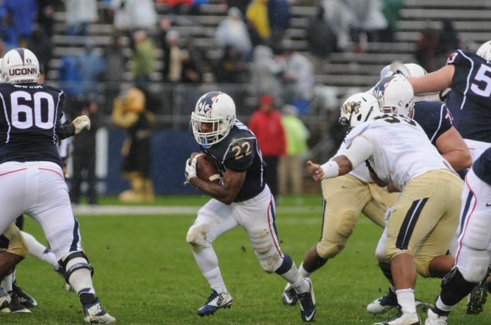 """UConn running back Arkeel Newsome carries the ball during the first """"Civil Conflict"""" against UCF on November 1, 2014 at Rentschler Field in Hartford. Following the game, head coach Bob Diaco decided to create a rivalry between the Huskies and the Knights. (File Photo/The Daily Campus)"""