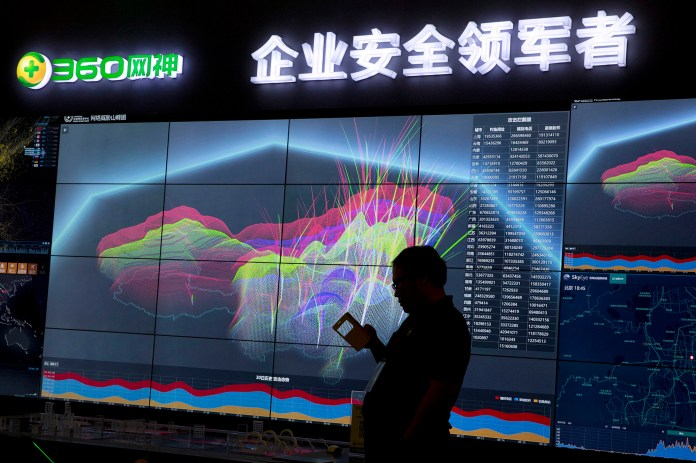 In this Aug. 16, 2016 file photo, a worker is silhouetted against a computer display showing a live visualization of the online phishing and fraudulent phone calls across China during the 4th China Internet Security Conference (ISC) in Beijing. A recall of Chinese-made technology in the US has been called due to the cyberattack that shut down Twitter and Netflix. (Ng Han Guan/ AP)