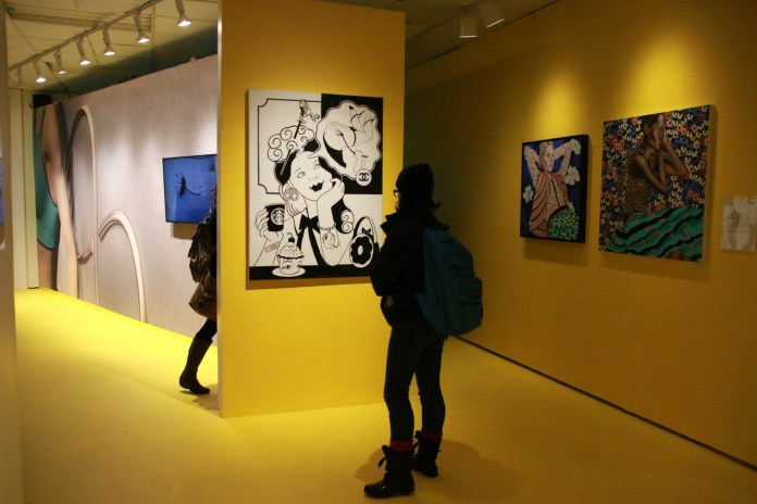 Students attend the opening reception for Glamour: A Dialogue Concerning Looking and Looks Exhibition in the Contemporary Arts Gallery on Thursday Oct 27, 2016. The exhibition runs through Dec. 9, 2016. (Yuwei Zhao/The Daily Campus)