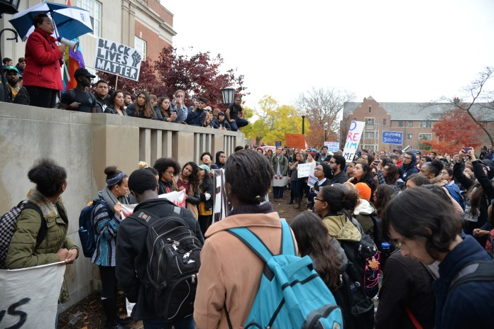 """UConn Chief Diversity Officer Joelle Murchison addresses students at the """"Rally for the People"""" as rally organizer Eric Cruz Lopez looks on outside Wilbur Cross on Wednesday, Nov. 9, 2016. The rally was organized by undocumented students at the university to protest the election results. (Amar Batra/The Daily Campus)"""