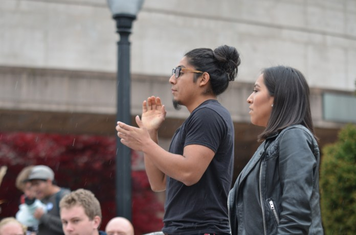 """Rally organizer Eric Cruz Lopez leads a chant during the """"Rally for the People"""" to protest the election results on Wednesday, Nov. 9, 2016 (Akshara Thejaswi/The Daily Campus)"""