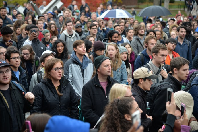 """Senator Mae Flexer and Representative Greg Haddad attend the """"Rally for the People"""" to protest the election results on Wednesday, Nov. 9, 2016. (Amar Batra/The Daily Campus)"""