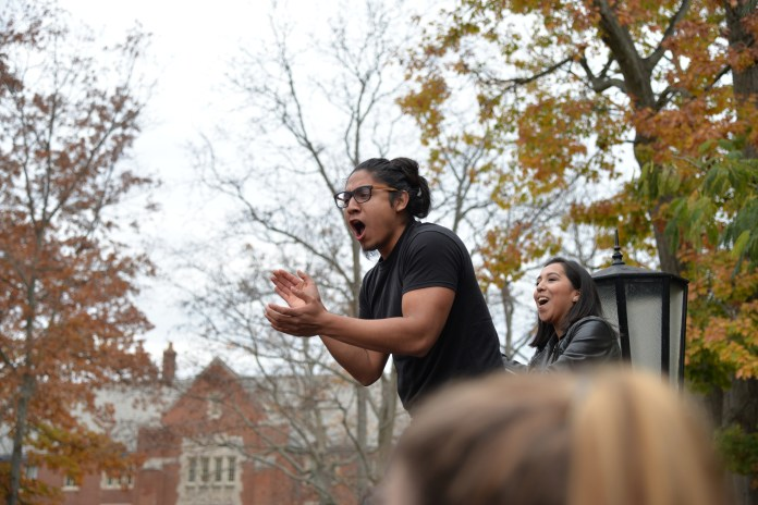 """UConn student Eric Cruz Lopez asks students for a verbal commitment to support future protests at the end of the """"Rally for the People"""" on Nov. 9, 2016. (Amar Batra/The Daily Campus)"""