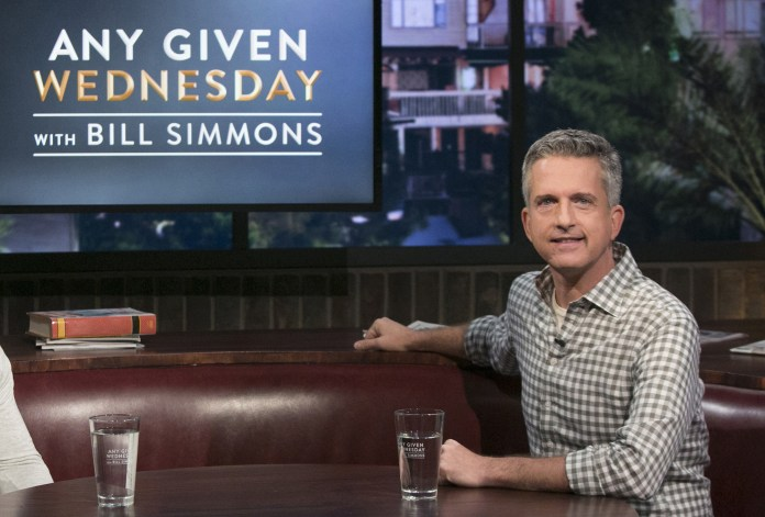 """This image released by HBO shows Bill Simmons on the set of """"Any Given Wednesday with Bill Simmons."""" HBO canceled the weekly talk show is ending its run after less than five months. The last episode will air on Nov. 9. (Jordin Althaus/AP)"""