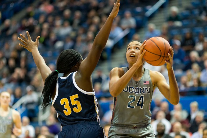 Sophomore Napheesa Collier going for a shot against Chatanooga's junior Aryanna Gilbert at the Nov. 29 game at the XL Center.(Tyler Benton/The Daily Campus)