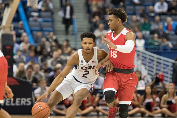 UConn men's basketball played Boston University last night at the XL Center in Hartford. They won 51-49 after a tough game. Pictured: Jalen Adams (2) vs a BU opponent.  (Jackson Haigis/ The Daily Campus)