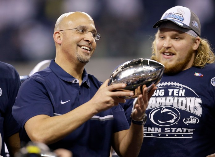 Penn State head coach James Franklin holds the trophy in front of defensive lineman Derek Dowrey after defeating Wisconsin to win the Big Ten championship NCAA college football game in Indianapolis on Dec. 4th 2016.(AJ Mast/AP Exchange)