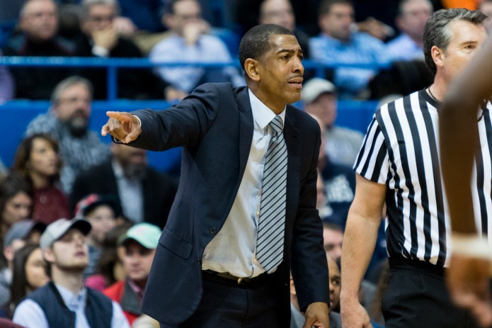 Head coach Kevin Ollie directs his team duing a 70-67 overtime loss to Auburn on Friday, Dec. 23 at the XL Center in Hartford. Ollie said that it's unacceptable that his team shot so poorly from 3-point range (4-28), and hopes the team can take it as a learning experience. (Jackson Haigis/The Daily Campus)