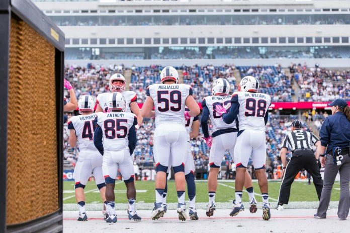 UConn players pump themselves up on the sideline during a football game against Cincinnati on October 8th, 2016 at Rentschler Field in East Hartford. (Jackson Haigis/The Daily Campus)