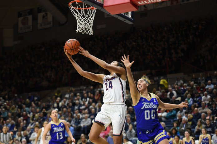 The Women's Basketball team defeated Tulsa 96-50 for their 97th straight win. Napheesa Collier led the team with 24 points. (Charlotte Lao/The Daily Campus)
