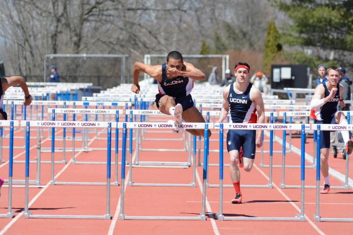 A UConn track and field athlete runs the hurdles at a meet in April of 2015. The Huskies took home first place in this weekend's Artie O'Connor Invitational. (Jason Jiang/The Daily Campus)
