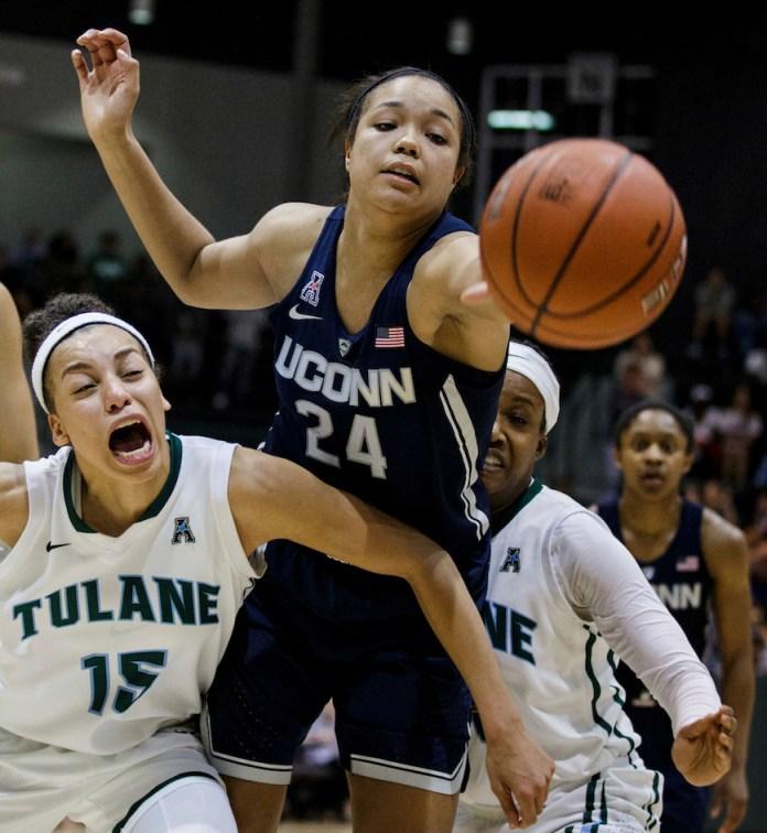 Tulane guard Tene Thompson (15) blocks Connecticut guard/forward Napheesa Collier (24) during the second half of an NCAA college basketball game in New Orleans, Saturday, Feb. 18, 2017. (AP Photo/Sophia Germer)