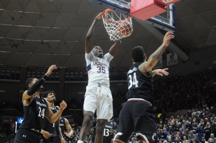 Amida Brimah (#35) dunks in UConn's loss to Cincinnati on Sunday March 5, at Gampel Pavilion. (Amar Batra/The Daily Cmapus)