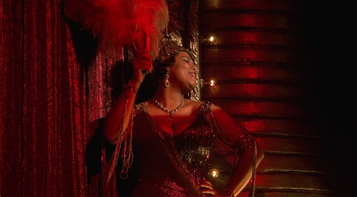 """Queen Latifa in musical comedy """"Chicago"""". The movie won an Academy Award for Best Picture in 2003. The movie is now available on Netflix. (screenshot/Nwtflix)"""