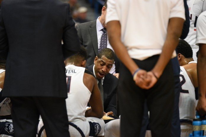 Kevin Ollie draws up a play in UConn's game against Memphis on Feb. 16, 2017 at the XL Center. (Zhelun Lang/The Daily Campus)