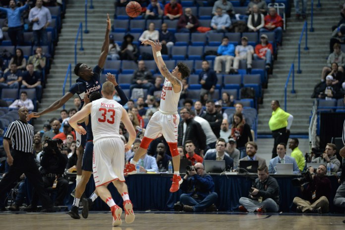 Amida Brimah attempts to block the shot of Houston's Rob Gray (32) in UConn's 74-65 win over Houston in the second round of the American Athletic Conference tournament on Friday, March 10, 2017 at the XL Center in Hartford. (Amar Batra/The Daily Campus)