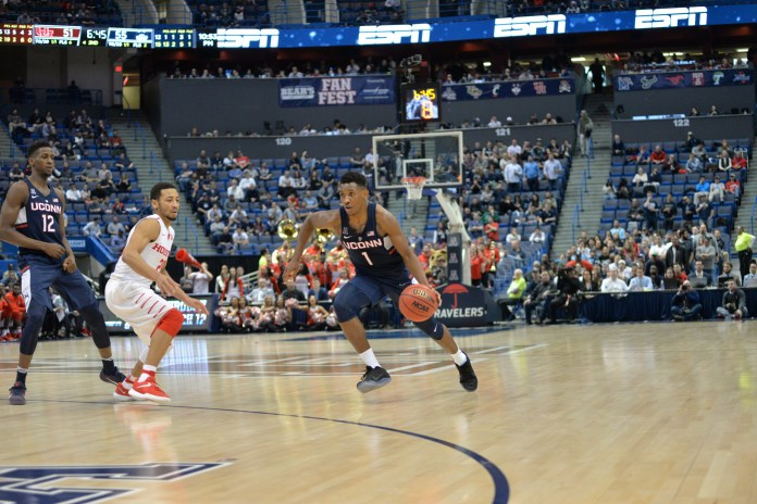 Christian Vital attempts to manuever past a Houston defender in UConn's 74-65 win over Houston in the second round of the American Athletic Conference tournament on Friday, March 10, 2017 at the XL Center in Hartford. (Amar Batra/The Daily Campus)