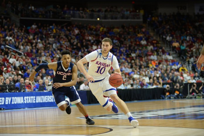 Kansas' Sviatoslav Mykhailiuk drives past UConn's Jalen Adams in the second round of the 2016 NCAA tournament on March 19, 2016. The Jayhawks beat the Huskies 73-61. (Ashley Maher/The Daily Campus)