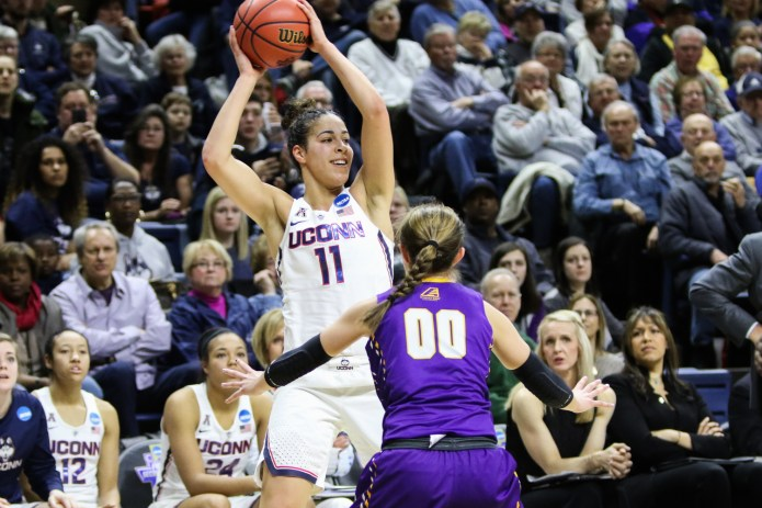 UConn's Kia Nurse smiles while looking to pass during UConn's 116-55 win over Albany on Saturday afternoon at Gampel Pavilion in the first round of the NCAA Tournament. Nurse scored 24 points for the Huskies, shooting 8-for-10 from the field and 6-for-7 from three-point range. (Jackson Haigis/The Daily Campus)