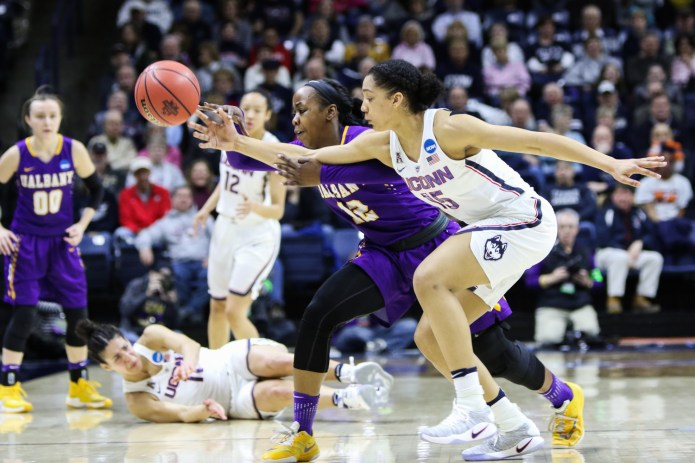 UConn's Gabby Williams fights Albany's Imani Tate for the ball in the first half of the Huskies' 116-55 win over the Great Danes on Saturday afternoon at Gampel Pavilion in the first round of the NCAA Tournament. Williams had a double-double with 20 points and 10 rebounds. (Jackson Haigis/The Daily Campus)