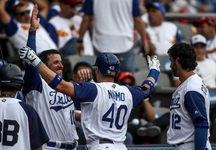Italy's Brandon Nimmo celebrates with teammates after hitting a home run against Venezuela during a World Baseball Classic game in Guadalajara, Mexico, Saturday, March 11, 2017. (AP Photo/Luis Gutierrez)