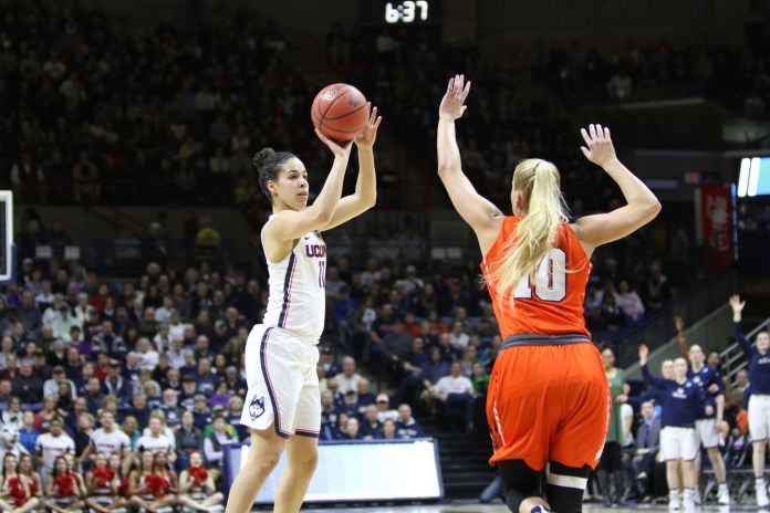 UConn's Kia Nurse (#11) fires up a shot over Syracuse forward Isabella Slim in the thirty point victory. (Jackson Haigis/The Daily Campus)